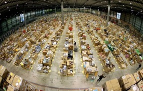 Workers are seen in the Amazon.co.uk warehouse in Milton Keynes, north of London